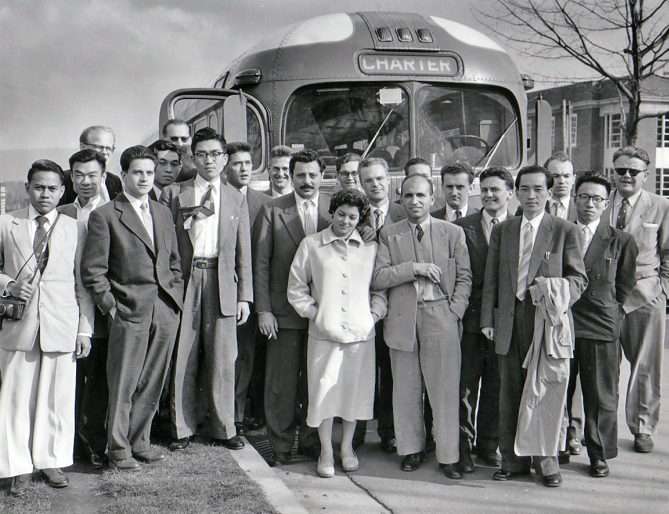 International Scientist photo in front of a bus